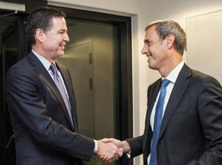 Europol Director Rob Wainwright with the Director of FBI James Comey 2015