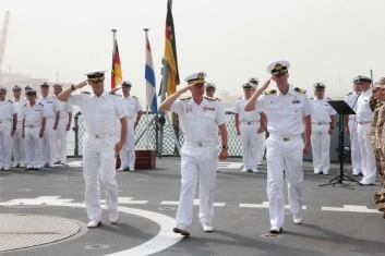 Rear Admiral Kaack, Rear Admiral González-Aller Lacalle, and Commodore Luyckx in the change of Force Command ceremony. August 6, 2016 EU NAVFOR